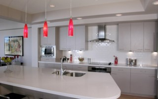 modern kitchen with red pendant lighting - lightstyleoforlando