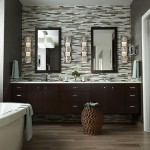bathroom with elongated light fixtures on either side of the mirrors