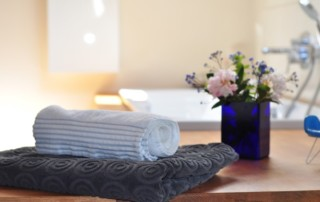 bathroom interior with towels and flowers